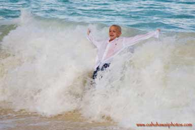 young boy body surfing in the waves Waimanalo Beach