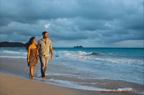young couple walking on the beach sunrise at Waimanalo Beach Oahu Hawaii