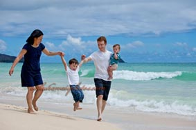 Waimanalo Beach Family portrait walking on the beach holding hands
