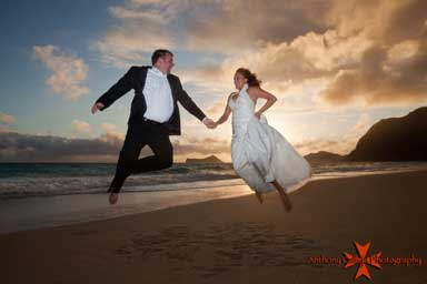 Bride and Groom Jumping in the air Waimanalo Oahu Hawaii