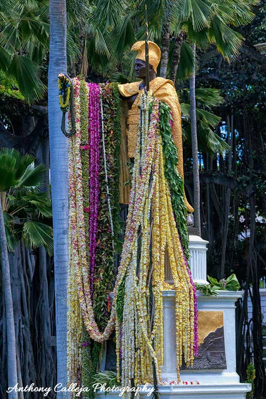 King Kamehameha statue draped with flower leis in celebration of Kamehameha Day
