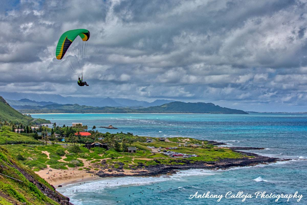 Photo of an individual hang gliding above Makapuu Beach photographed from Makapuu Lookout, Oahu, Hawaii