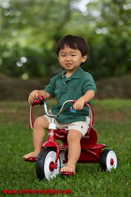 Child on a tricycle, Moanalua Gardens, Honolulu, Hawaii
