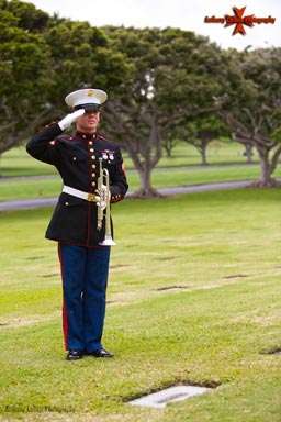 A U.S. Marine Salutes a Grave marked unknown
