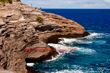 Cliff Jumper Jumps at Spitting Cave of Portlock, Oahu, Hawaii