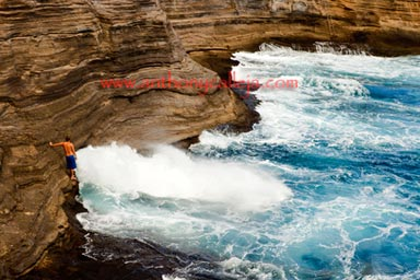 Cliff Jumper observes the Spitting Cave at Portlock Oahu Hawaii