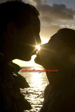 Hawaii Wedding Portrait - Photographed at Sunset - Silhouette of the Bride and Groom with a Sun Star Kiss