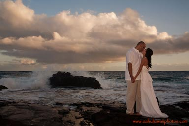 Wedding Photo of Young couple on their wedding day photographed at dusk at Sandy Beach on the east side of the island of Oahu Hawaii