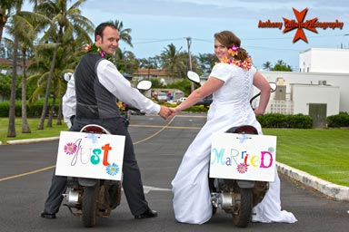 Just Married! Bride and groome at laie Temple on mopeds
