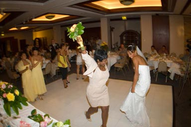 Wedding Photo of Bouquet Toss at Wedding Reception in Kailua Hawaii