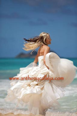 Bride Dancing on the white sands of Waimanalo Beach Oahu Hawaii