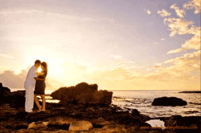 Photographer Near Marriott Koolina Beach Villas Engagement Young couple at Sunset at Secret Beach Oahu Hawaii