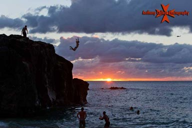 Cliff Jumper at Sunset Wamea Bay North Shore Oahu Hawaii